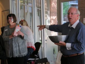 Picture of man raffling off winners at employee appreciation event