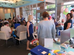 Picture of Peak Performers staffing agency office in Austin TX filled with people for employee appreciation event.